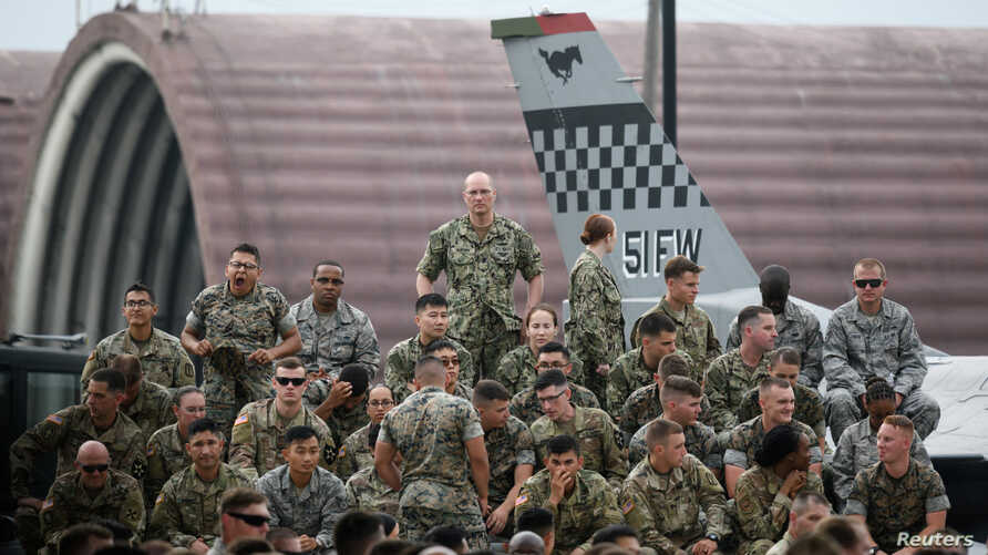 U.S. soldiers wait for a speech by U.S. President Donald Trump (not pictured) as he meets U.S. troops based in Osan Air Base,…