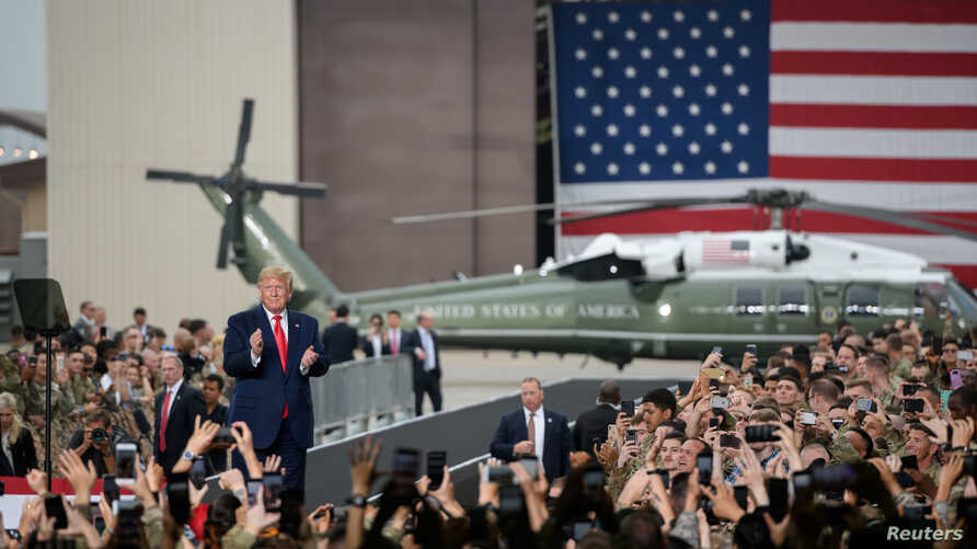 U.S. President Donald Trump visits U.S. troops based in Osan Air Base, South Korea June 30, 2019. Ed Jones/Pool via REUTERS