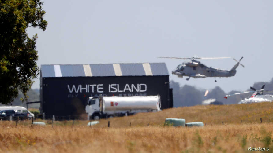 A military helicopter flies at the airport during the rescue mission following the White Island volcano eruptions in Whakatane,…