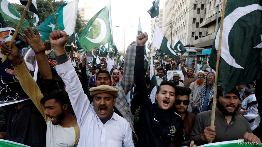 Supporters of Pervez Musharraf chant slogans, after a Pakistani court sentenced the former military ruler to death on charges…