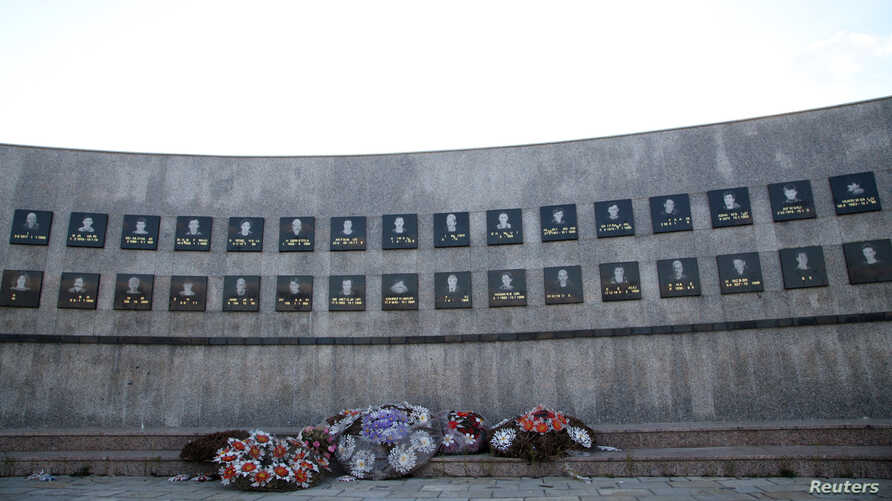 Flowers are seen placed at the memorial to the victims of the Recak massacre, where forty-five ethnic Albanians were killed by…