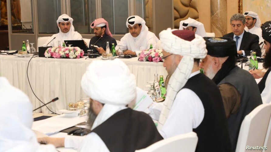 Undated handout picture of U.S., Taliban and Qatar officials during a meeting for peace talks in Doha, Qatar. Qatari Foreign…