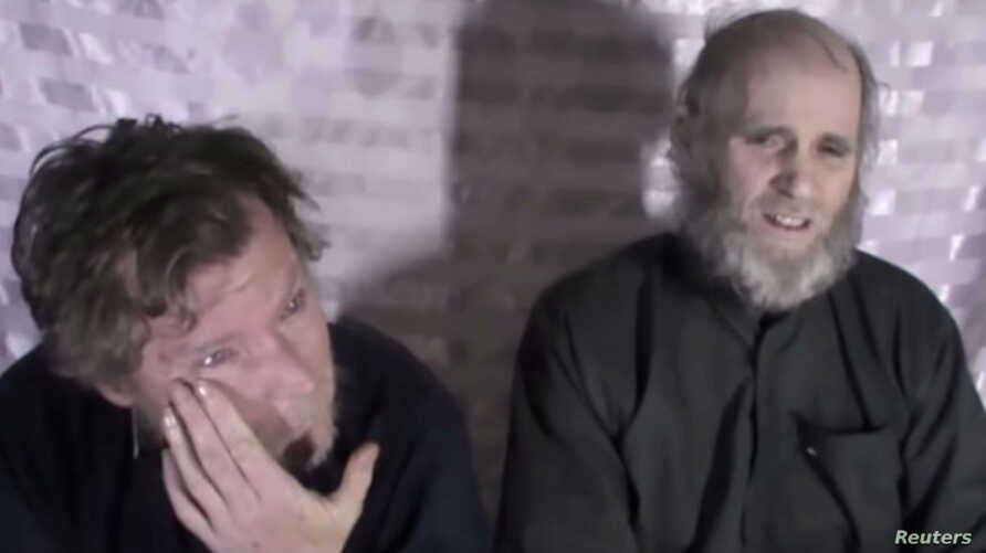 Timothy Weeks and Kevin King speak to the camera while kept hostage by Taliban insurgents in an unknown location, said to be…