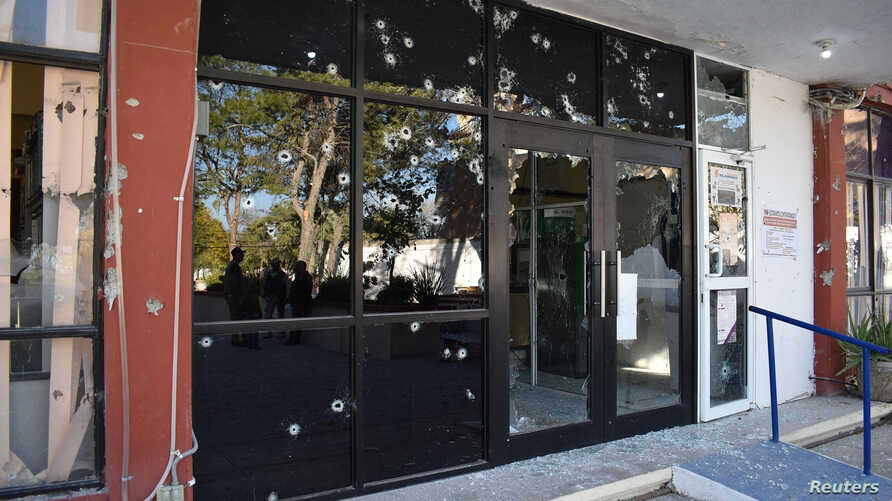 A view of the bullet-riddled facade of the town hall of Villa Union after clashes sparked by suspected cartel gunmen in a…