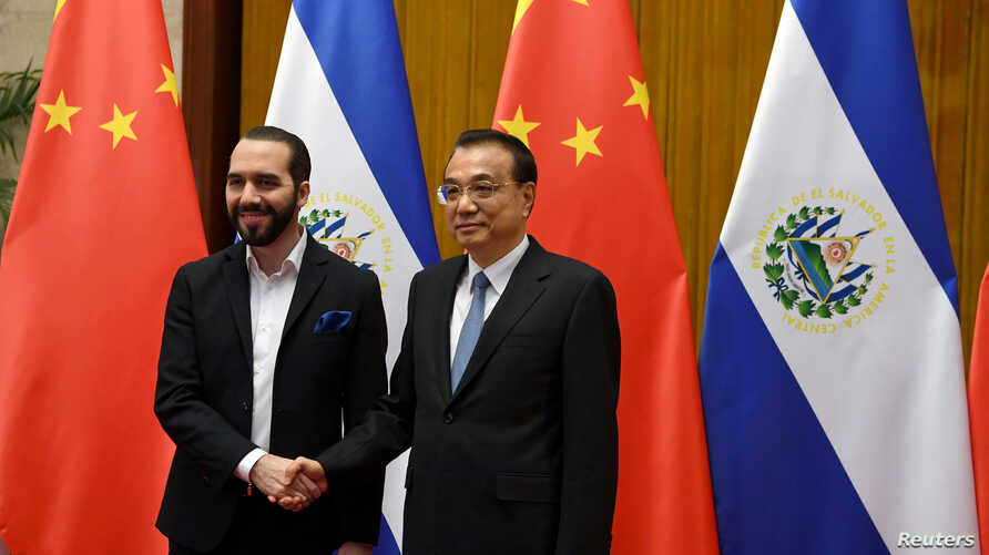 El Salvador's President Nayib Bukele meets with China's Premier Li Keqiang at the Great Hall of the People in Beijing, China…