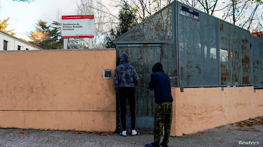 Two young people wait to enter at minors' reception center in the Hortaleza district in Madrid, Spain, December 5, 2019…