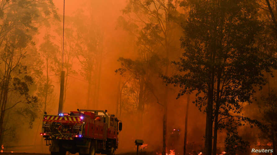 Fire trucks are seen during a bushfire in Werombi, 50 km southwest of Sydney, Australia, December 6, 2019. AAP Image/Mick…
