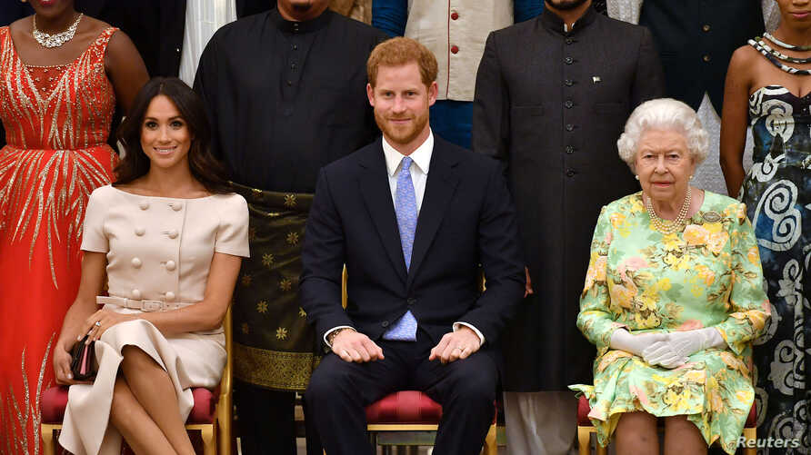 FILE PHOTO: Britain's Queen Elizabeth, Prince Harry and Meghan, the Duchess of Sussex, pose for a picture at in London, Britain…