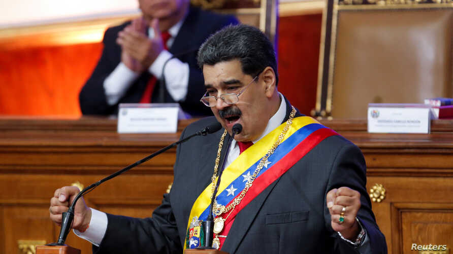 Venezuela's President Nicolas Maduro delivers his annual state of the nation speech during a special session of the National…