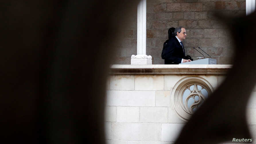 The leader of Catalonia's regional government Quim Torra delivers a statement at Palau de la Generalitat in Barcelona, Spain,…