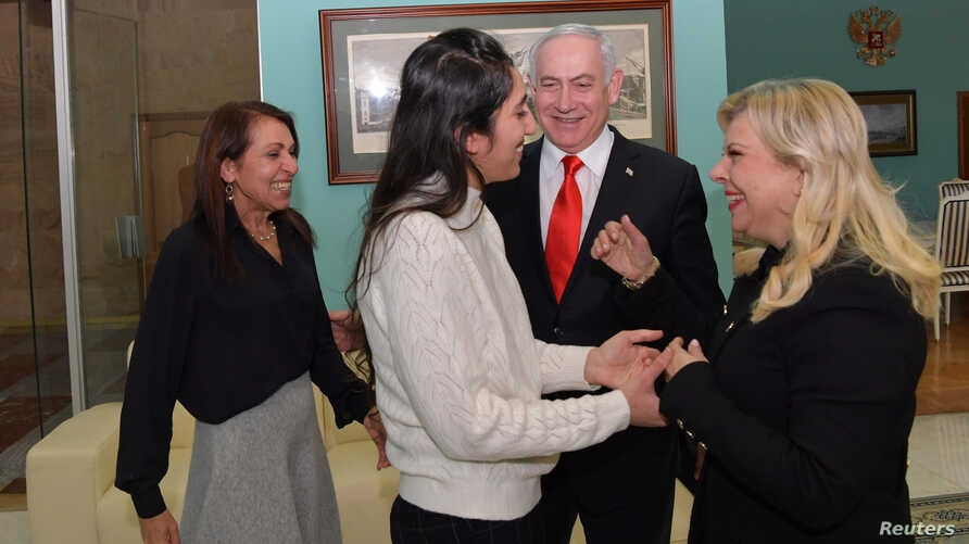 Israeli Prime Minister Benjamin Netanyahu and his wife Sara, meet Naama Issachar and her mother Yaffa in Moscow, Russia January…