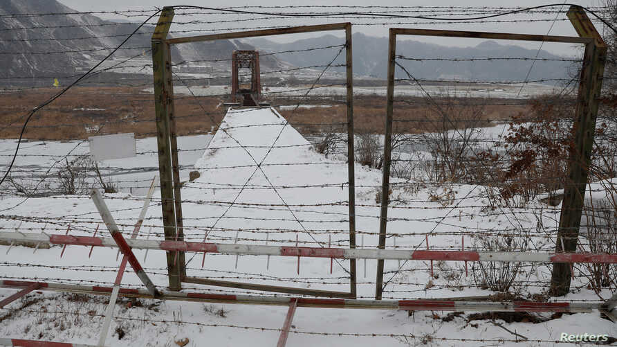 A gate is closed on a bridge over the Yalu River, on the Chinese side of the border with North Korea between the towns of Ji'an…