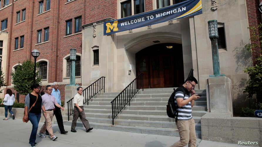 """A """"Welcome"""" banner is seen on a University of Michigan building in Ann Arbor, Michigan, U.S., September 19, 2018.  Picture…"""