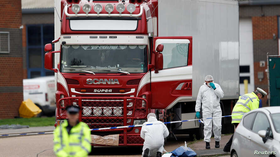 Police are seen at the scene where bodies were discovered in a lorry container, in Grays, Essex, Britain October 23, 2019. …