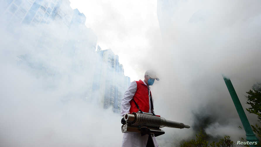 A volunteer disinfects a residential compound to prevent and control the novel coronavirus, in Ganzhou, Jiangxi province, China…