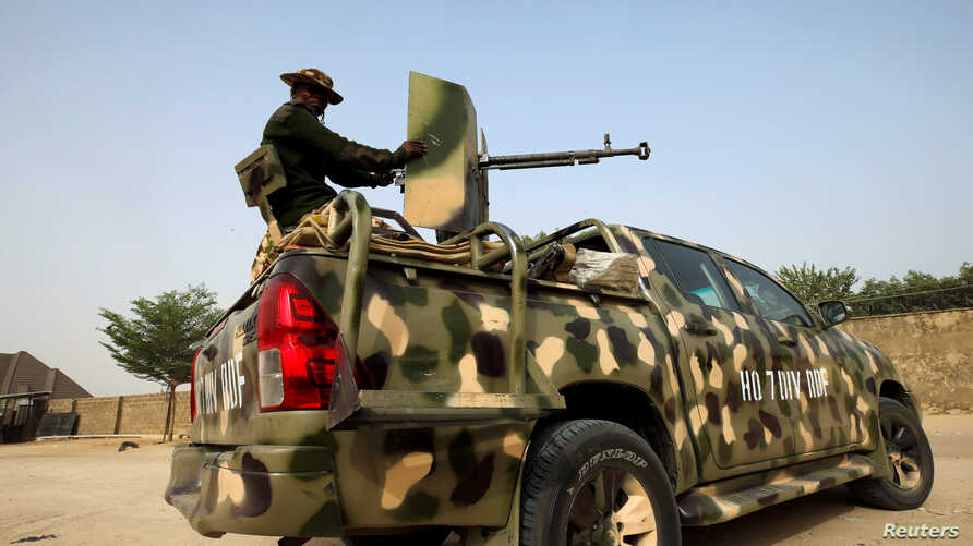 FILE PHOTO: Nigerian military prepare to cordon the area where a man was killed by suspected militants during an attack around…