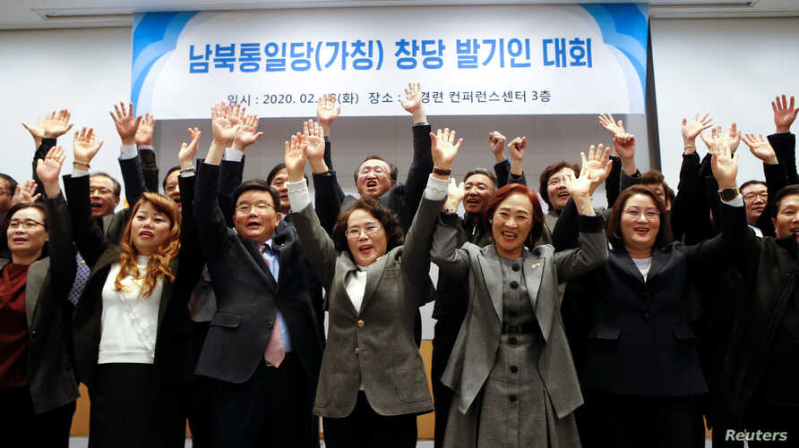 A group of North Korean defectors pose for photographs during the launching ceremony of their political party South-North…
