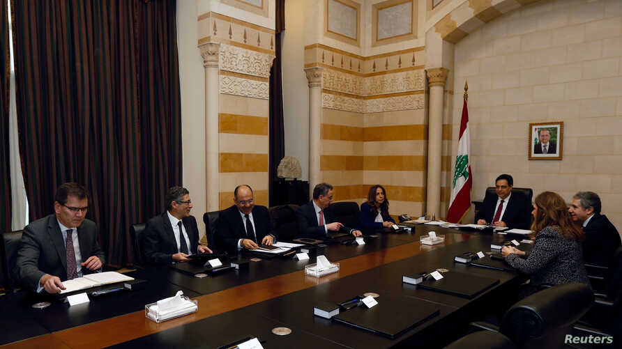 Lebanese Prime Minister Hassan Diab and officials meet with a team of IMF experts at the government palace in Beirut, Feb. 20, 2020.