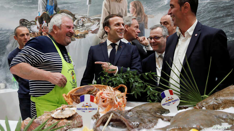 French President Emmanuel Macron visits the French fishing stand during the 57th International Agriculture Fair (Salon de l…
