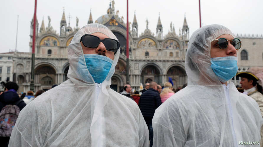 Tourists wear protective face masks at Venice Carnival, which the last two days of, as well as Sunday night's festivities, have…