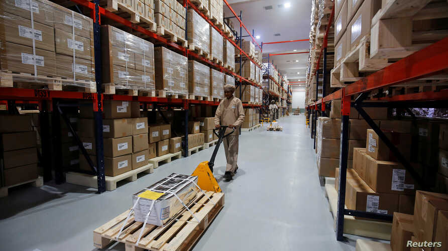An employee works inside the warehouse of Alembic Pharmaceutical Limited's plant in Halol, in the western state of Gujarat,…