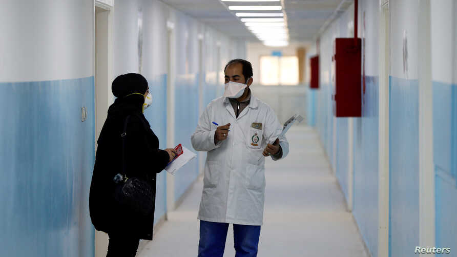 Members of the medical staff work at a new section specialised in receiving any person who may have been infected with…