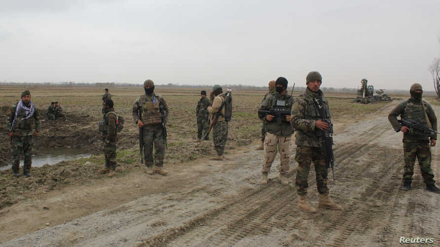 Afghan National Army (ANA) soldiers arrive at the site of last night clashes between Taliban and Afghan forces in Kunduz,…