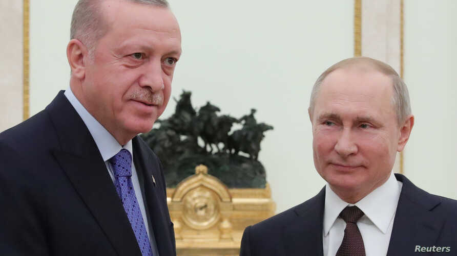 Russian President Vladimir Putin and Turkish President Tayyip Erdogan pose for a photo during a meeting in Moscow, Russia March…