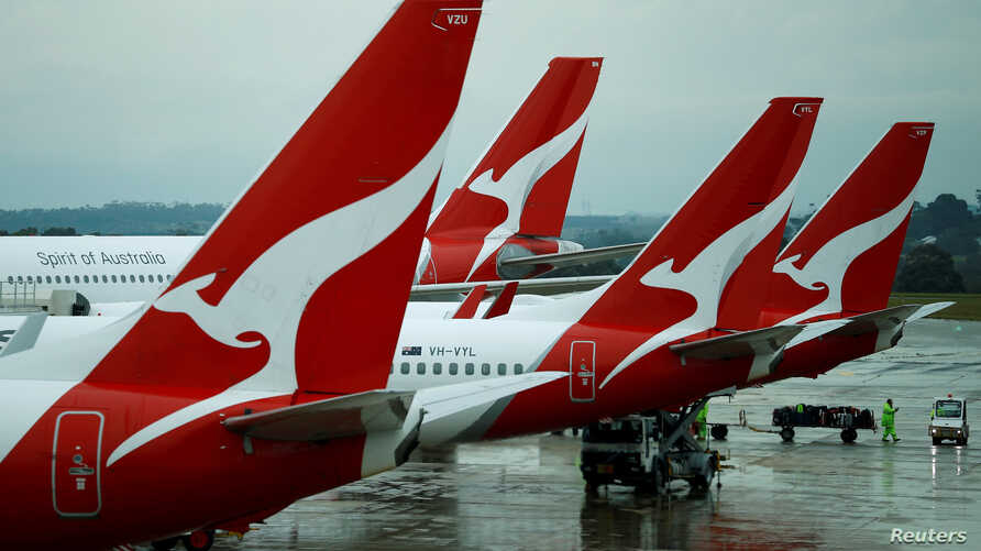 FILE PHOTO: Qantas aircraft are seen on the tarmac at Melbourne International Airport in Melbourne, Australia, November 6, 2018…