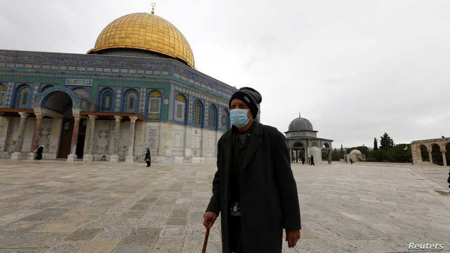 A worshipper walks in front of the Dome of the Rock in the compound known to Muslims as Noble Sanctuary and to Jews as Temple…