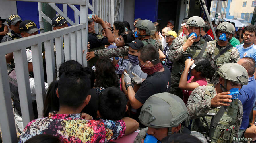 Soldiers control the access to the Gamarra textile market after Peru's government deployed military personnel to block major…