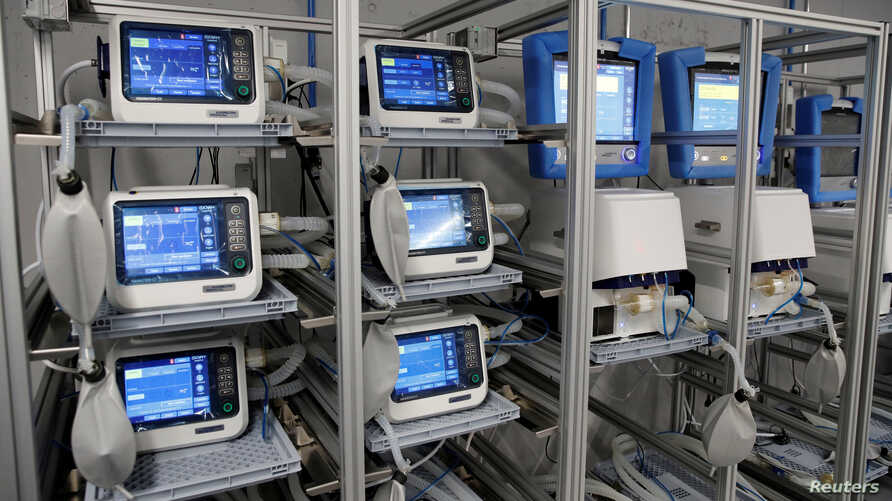 FILE PHOTO: Ventilators of Hamilton Medical AG are seen at a plant in Domat/Ems, Switzerland March 18, 2020. REUTERS/Arnd…