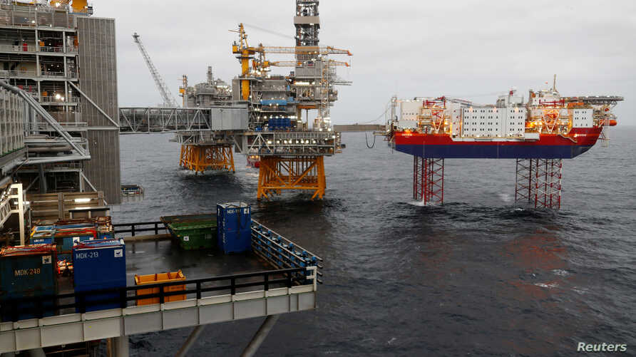 FILE PHOTO: Equinor's Johan Sverdrup oilfield platforms and accommodation jack-up rig Haven are pictured in the North Sea,…