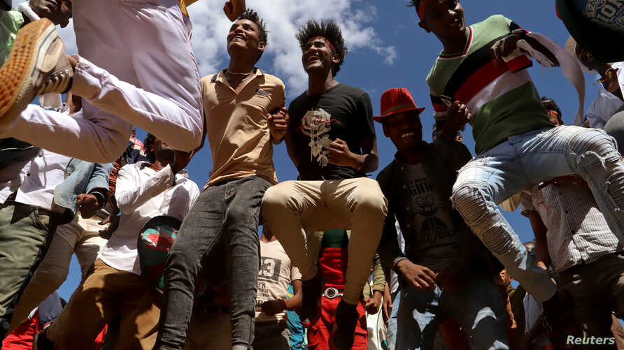 Youths dance during an Oromo Liberation Front (OLF) rally in the town of Woliso, Oromia region, Ethiopia, October 21, 2018…