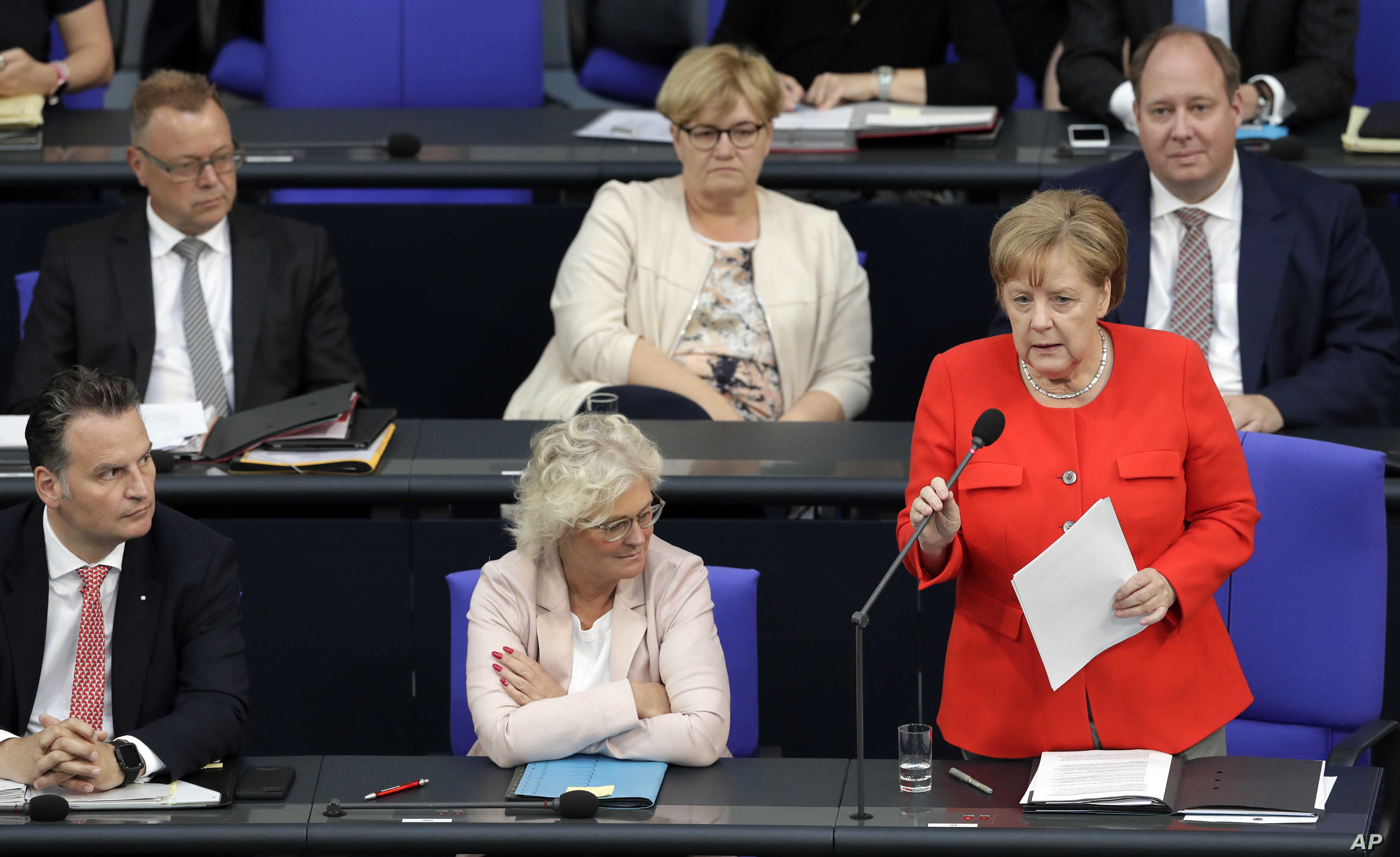 German Chancellor Angela Merkel delivers a statement on the G-7 summit prior to a government questioning as part of a meeting of the German parliament, Bundestag, at the Reichstag building in Berlin, Germany, June 6, 2018.