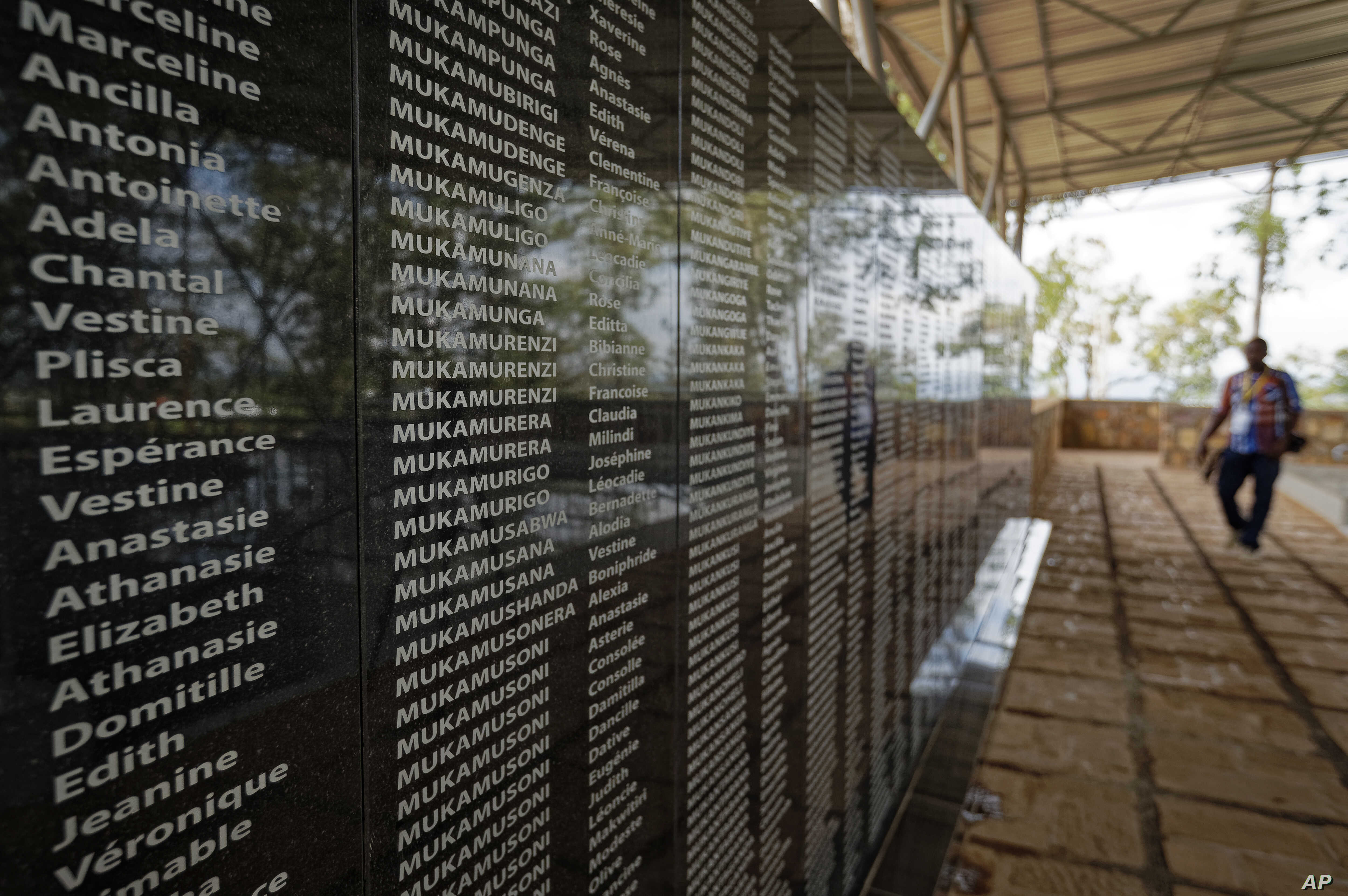 The names of those who were slaughtered as they sought refuge in the church, many with the same surname indicating a family, are written on a memorial to the thousands who were killed in the 1994 genocide in Rwanda.