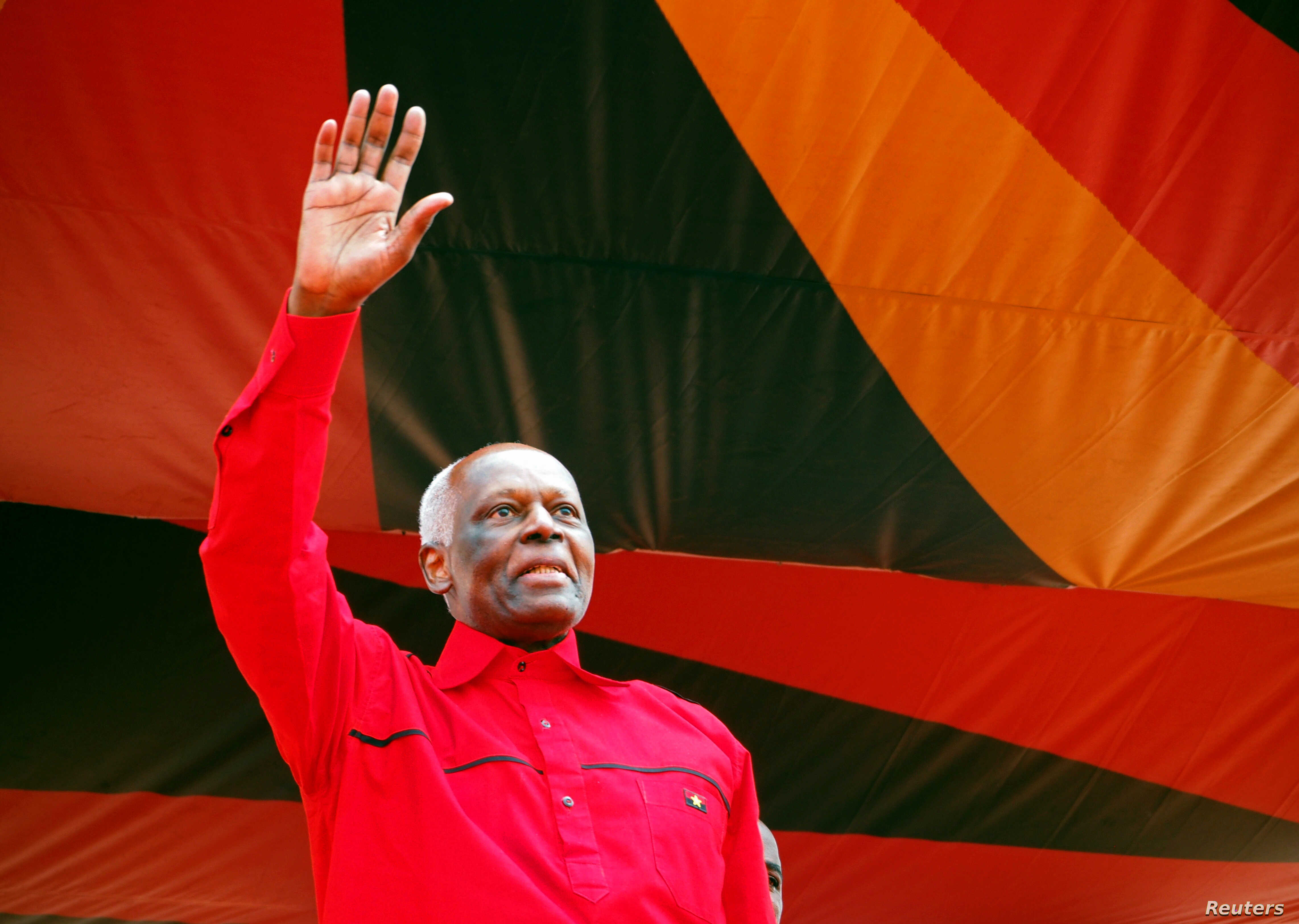 Outgoing Angolan President Jose Eduardo dos Santos greets crowds at the ruling MPLA party's final election rally in Luanda, Aug. 19, 2017.
