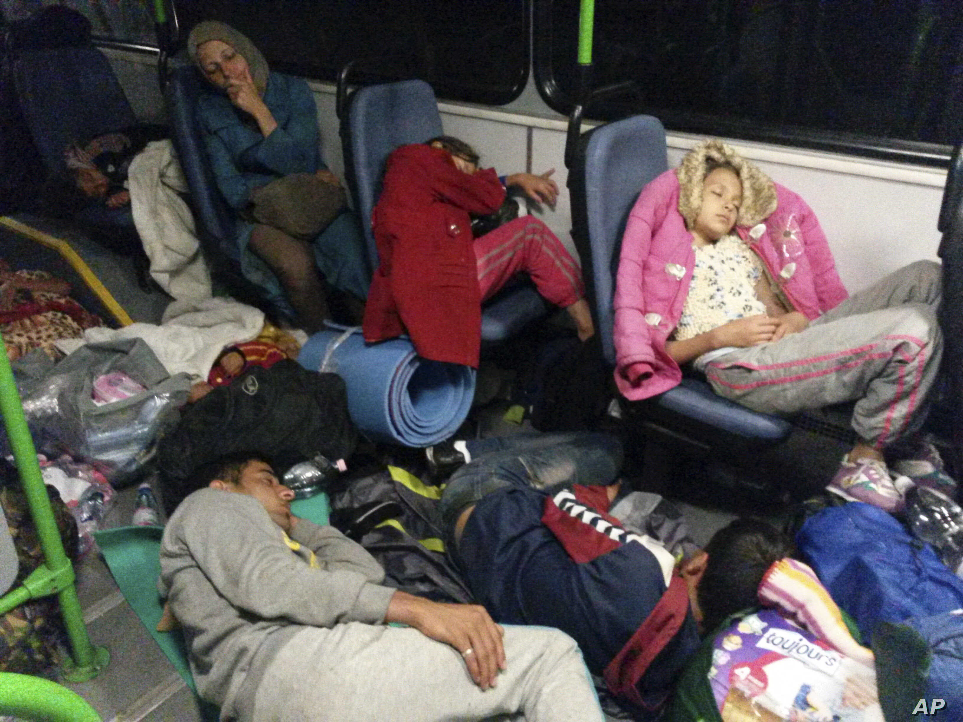 Migrants sit in a bus from Budapest to the Austrian border near Gyor, Hungary, Sept. 5, 2015.