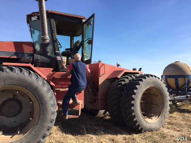 Rodney Grisier runs a farm three times as large as the average Kansas farm.  He'd like President Trump to be make the US more competitive with global agriculture exports. (C. Presutti/VOA)