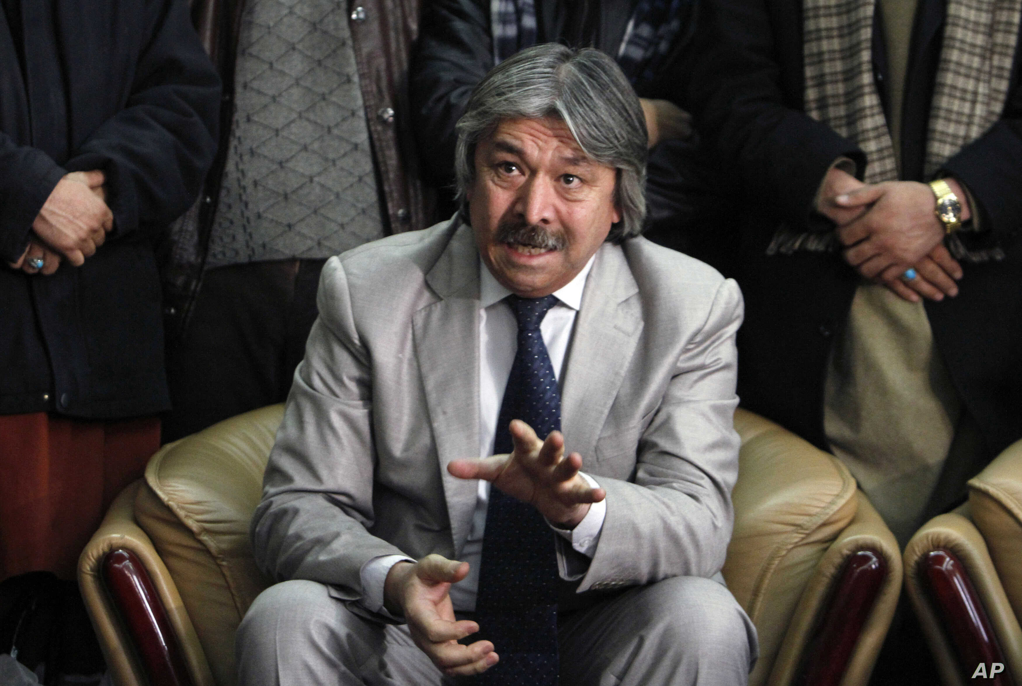 FILE - General Abdul Rashid Dostum speaks during a press conference at the airport in Kabul, Afghanistan, Friday, Jan. 13, 2012.