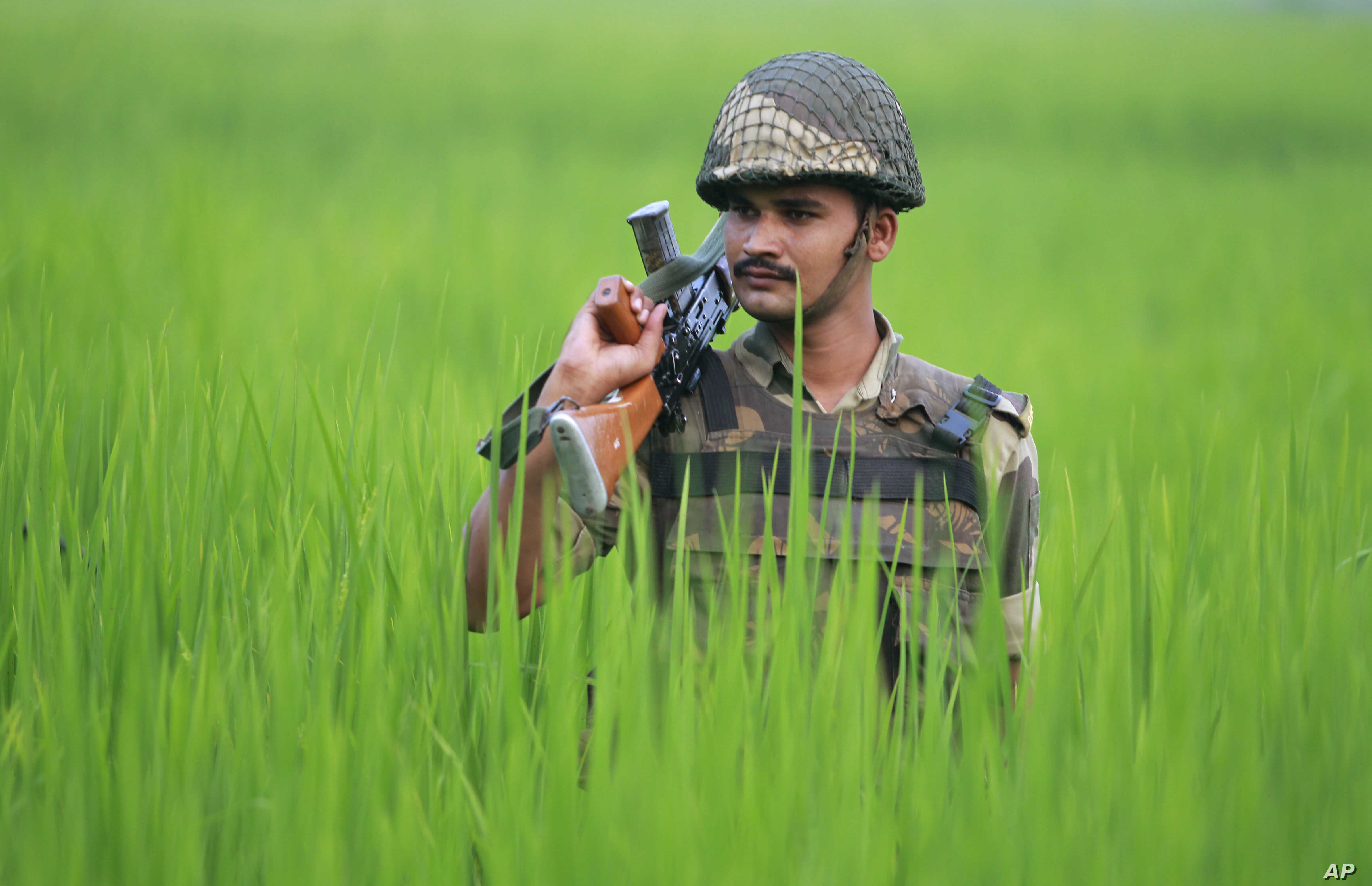 An Indian Border Security Force soldier patrols the India-Pakistan border area at Ranbir Singh Pura, about 35 kilometers (22 miles) from Jammu, India, Sept. 24, 2016.