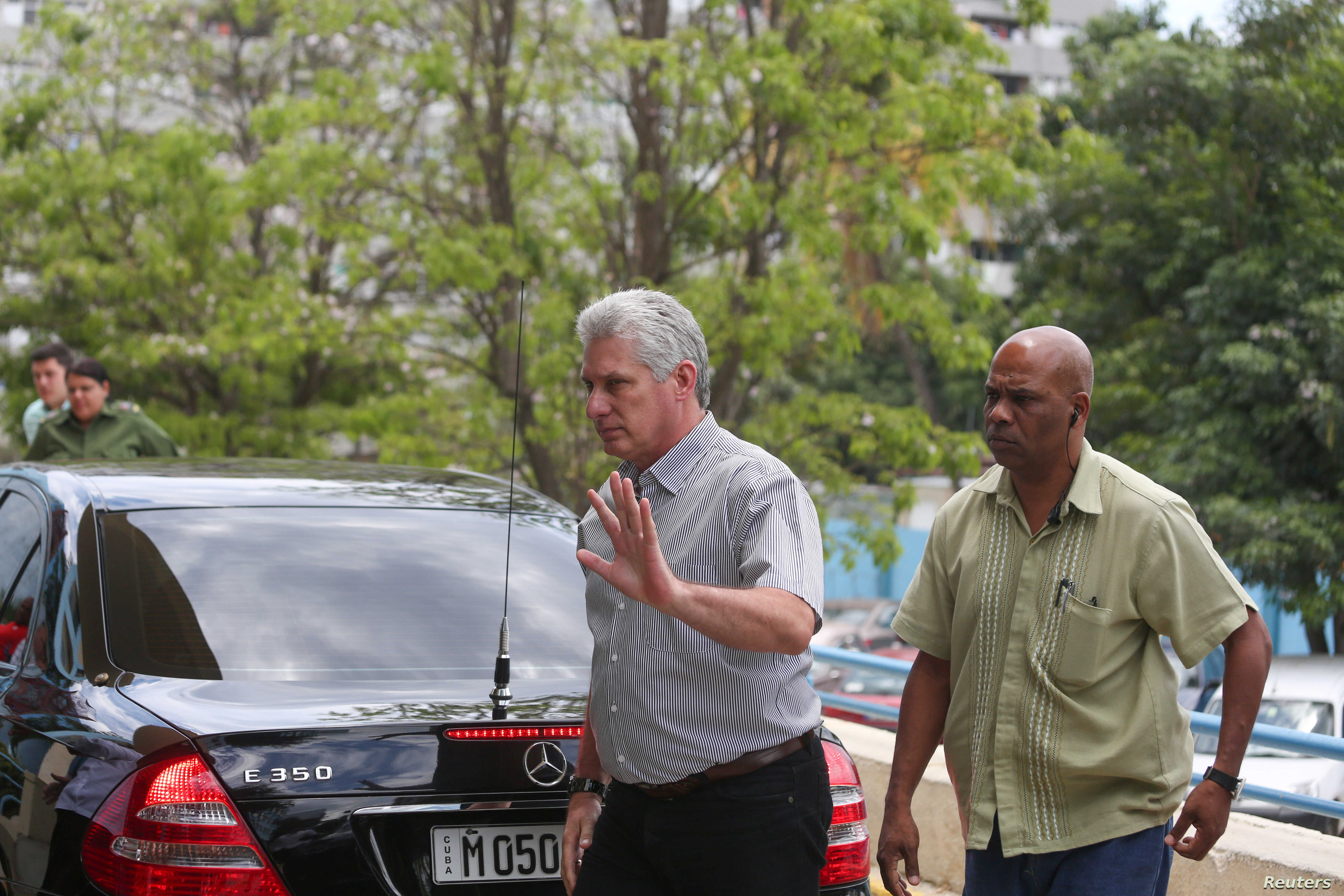 Cuba's President Miguel Diaz-Canel reacts as he arrives at a hotel to meet with relatives of victims of the previous day's Boeing 737 plane crash, in Havana, Cuba, May 19, 2018.