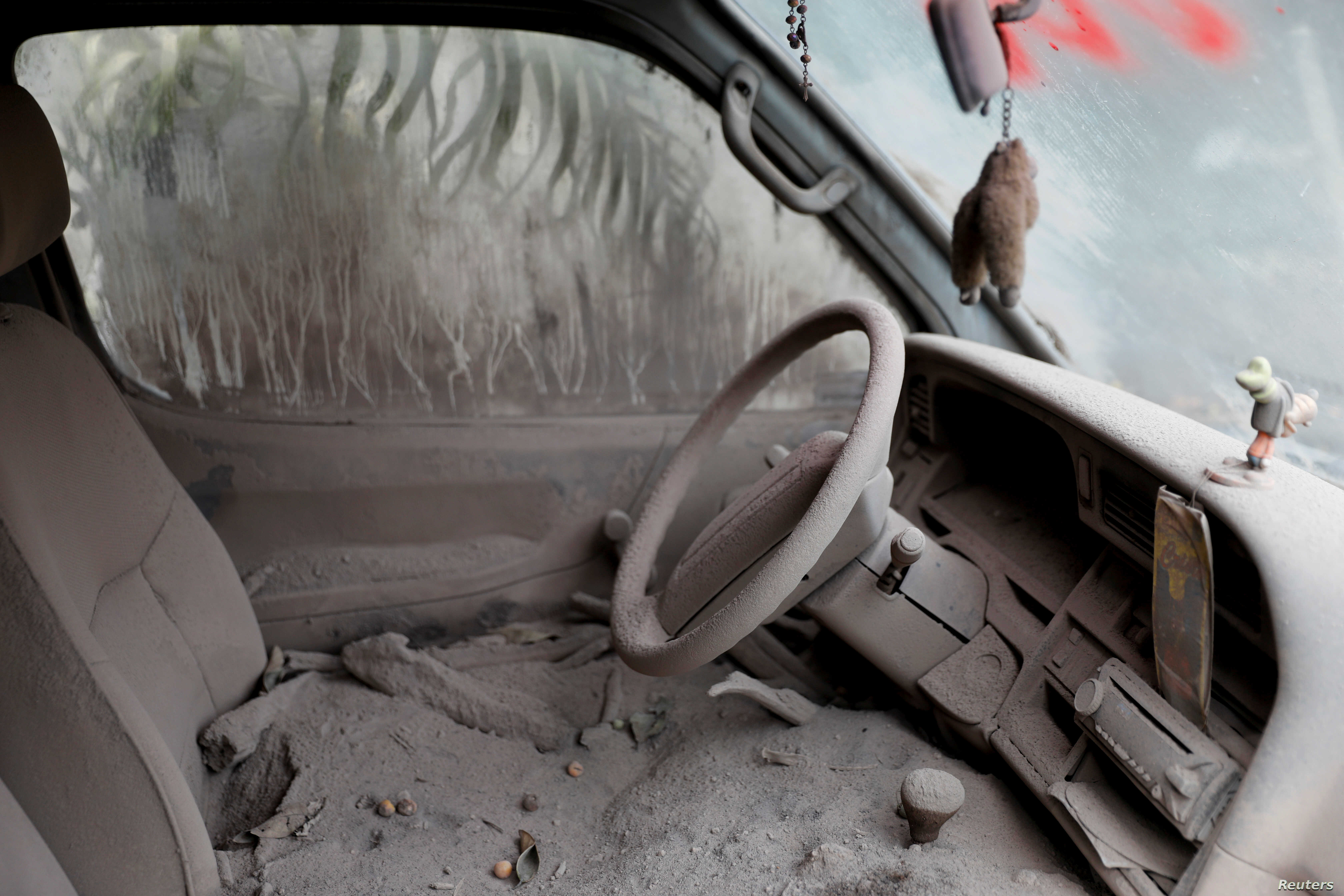 A car is seen covered in ash after the eruption of the Fuego volcano at San Miguel Los Lotes in Escuintla, Guatemala, June 10, 2018.