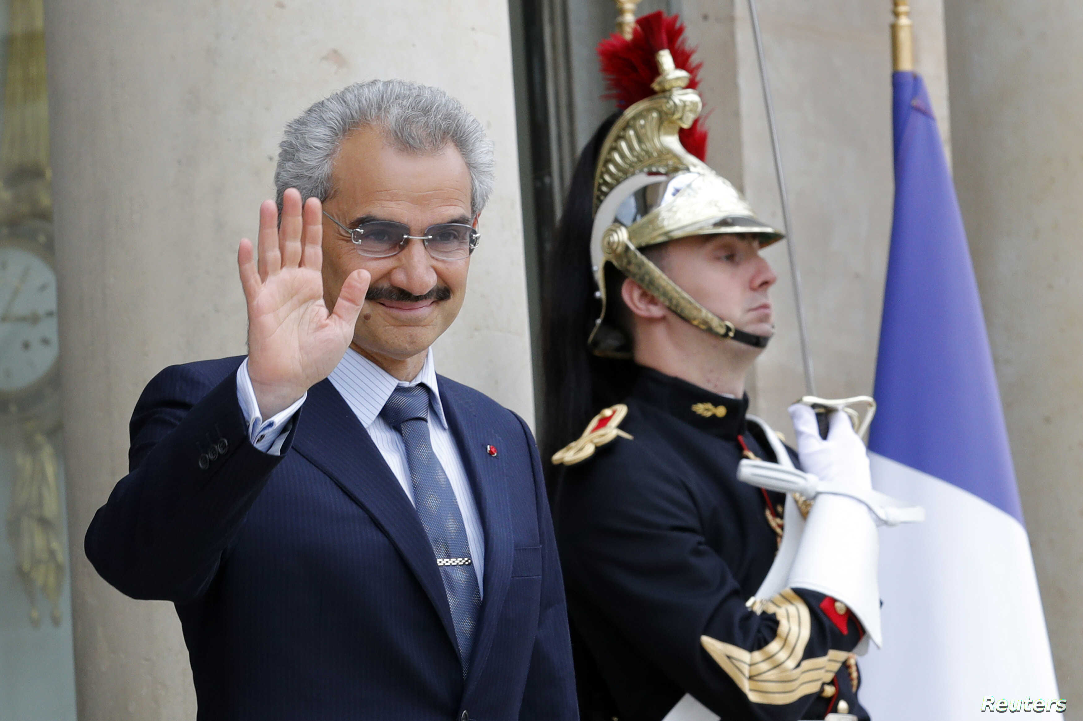 Saudi Arabian Prince Al-Waleed bin Talal arrives at the Elysee palace in Paris, to attend a meeting with the French president, Sept. 8 , 2016.