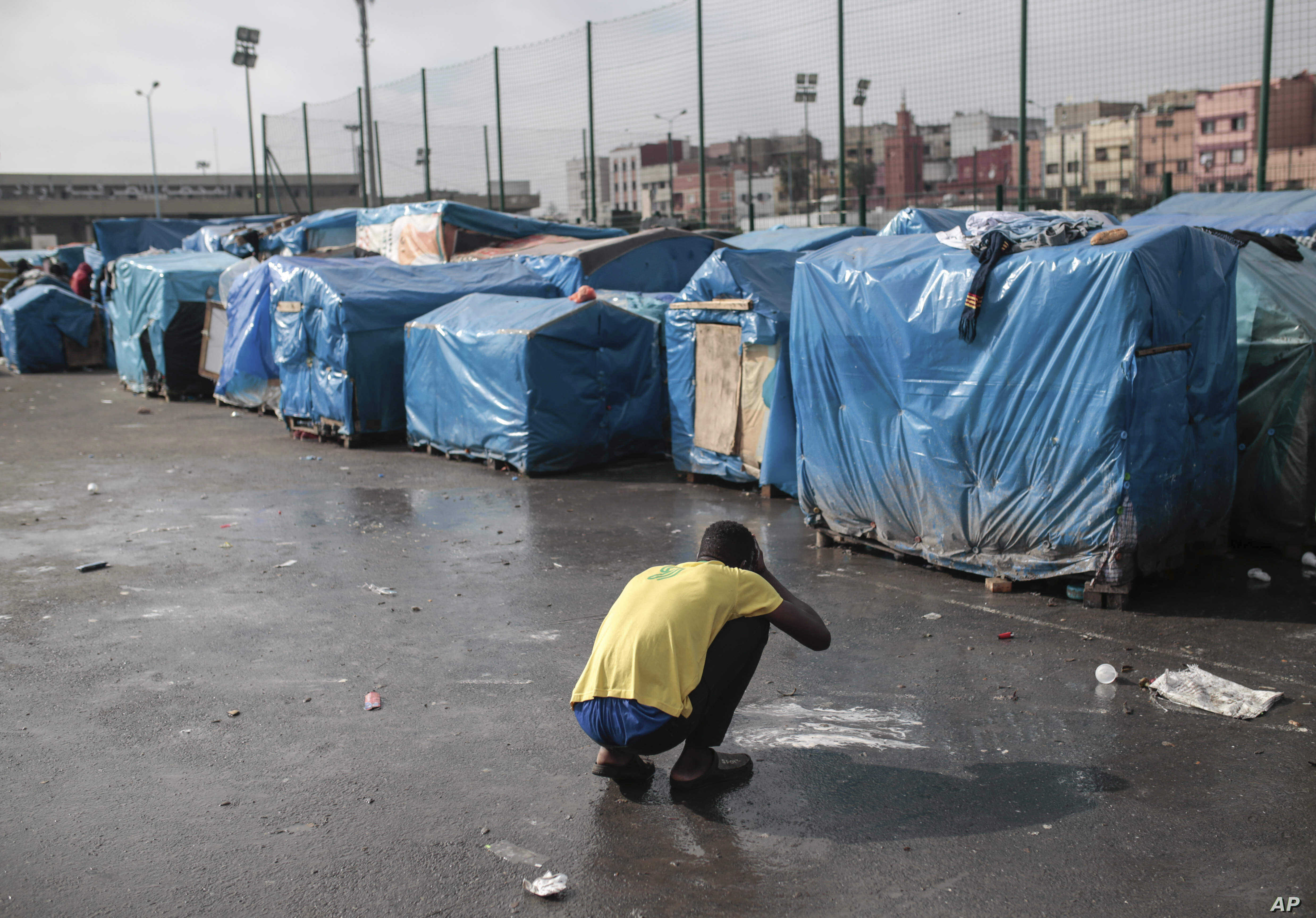 A sub-Saharan migrant washes at Ouled Ziane camp in Casablanca, Morocco, Dec. 6, 2018.