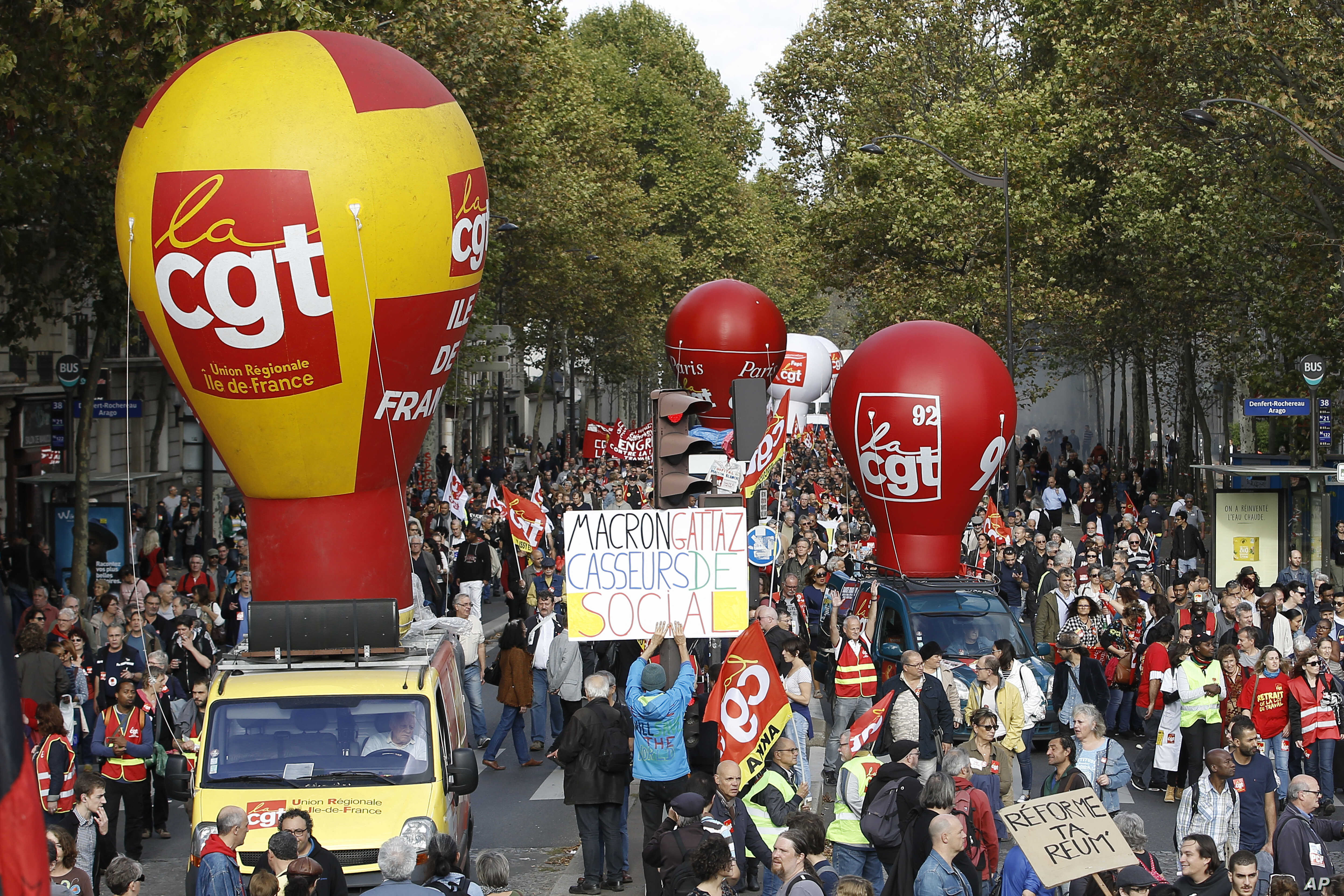 Protestors march during a demonstration against the labor reforms in Paris, Oct. 19 2017.