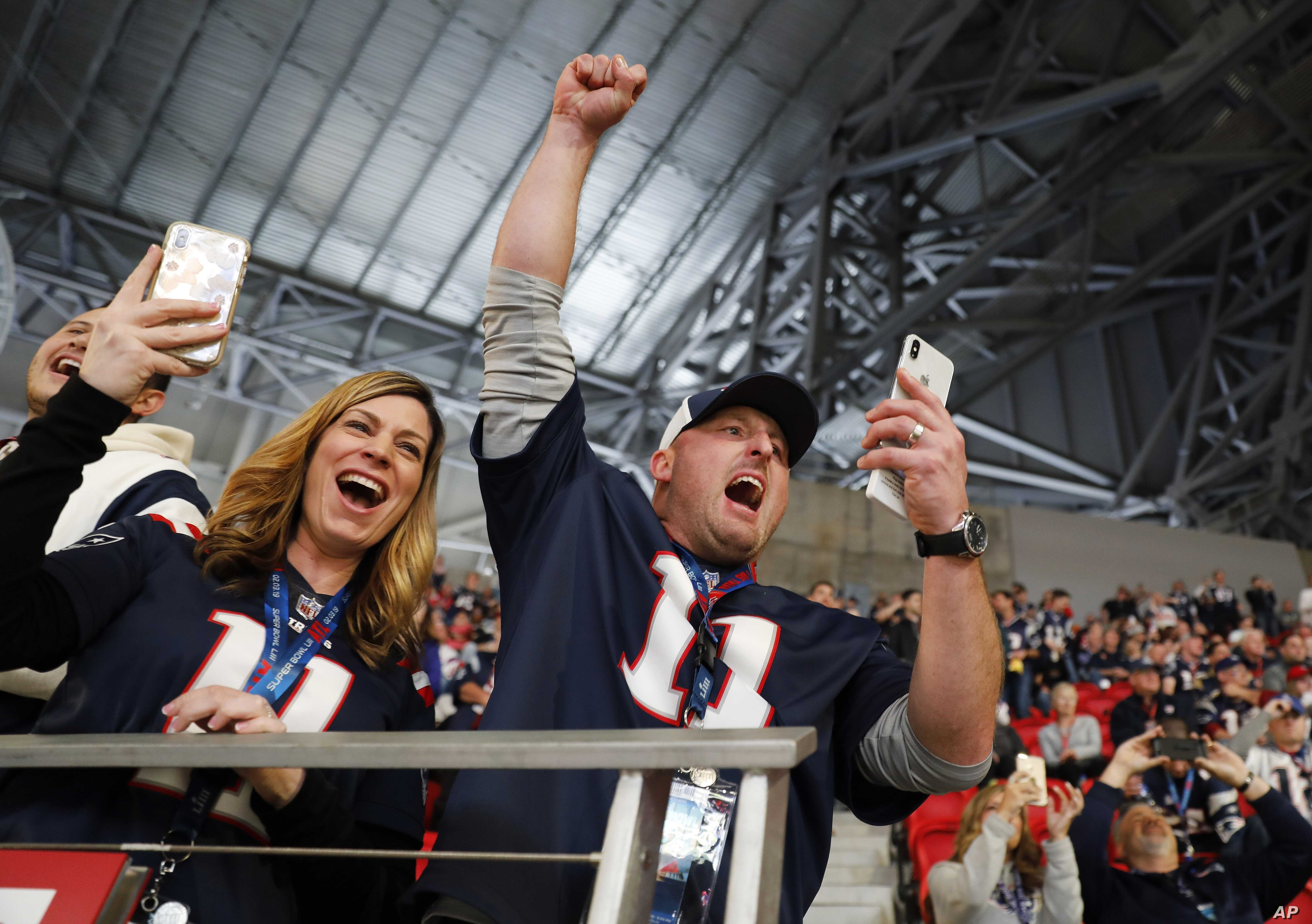 Fans cheer as the New England Patriots' Tom Brady takes the field before the NFL Super Bowl LIII football game between the Los Angeles Rams and the New England Patriots, Feb. 3, 2019, in Atlanta, Georgia.