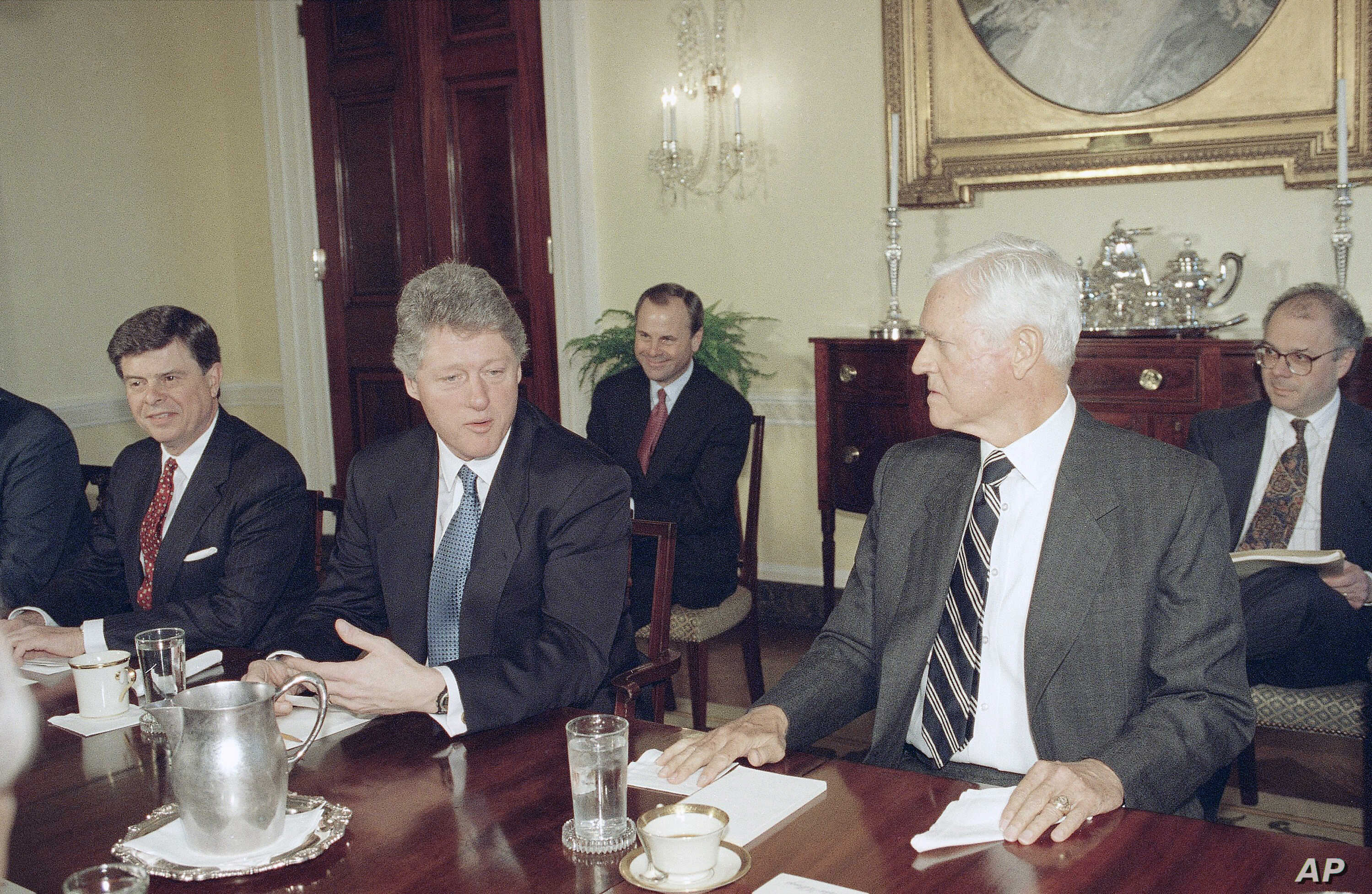 FILE - President Bill Clinton talks to Sen. Ernest Hollings, D-S.C., at the White House in Washington on March 9, 1993, during a meeting between the president and Democrats to discuss the president's economic package.