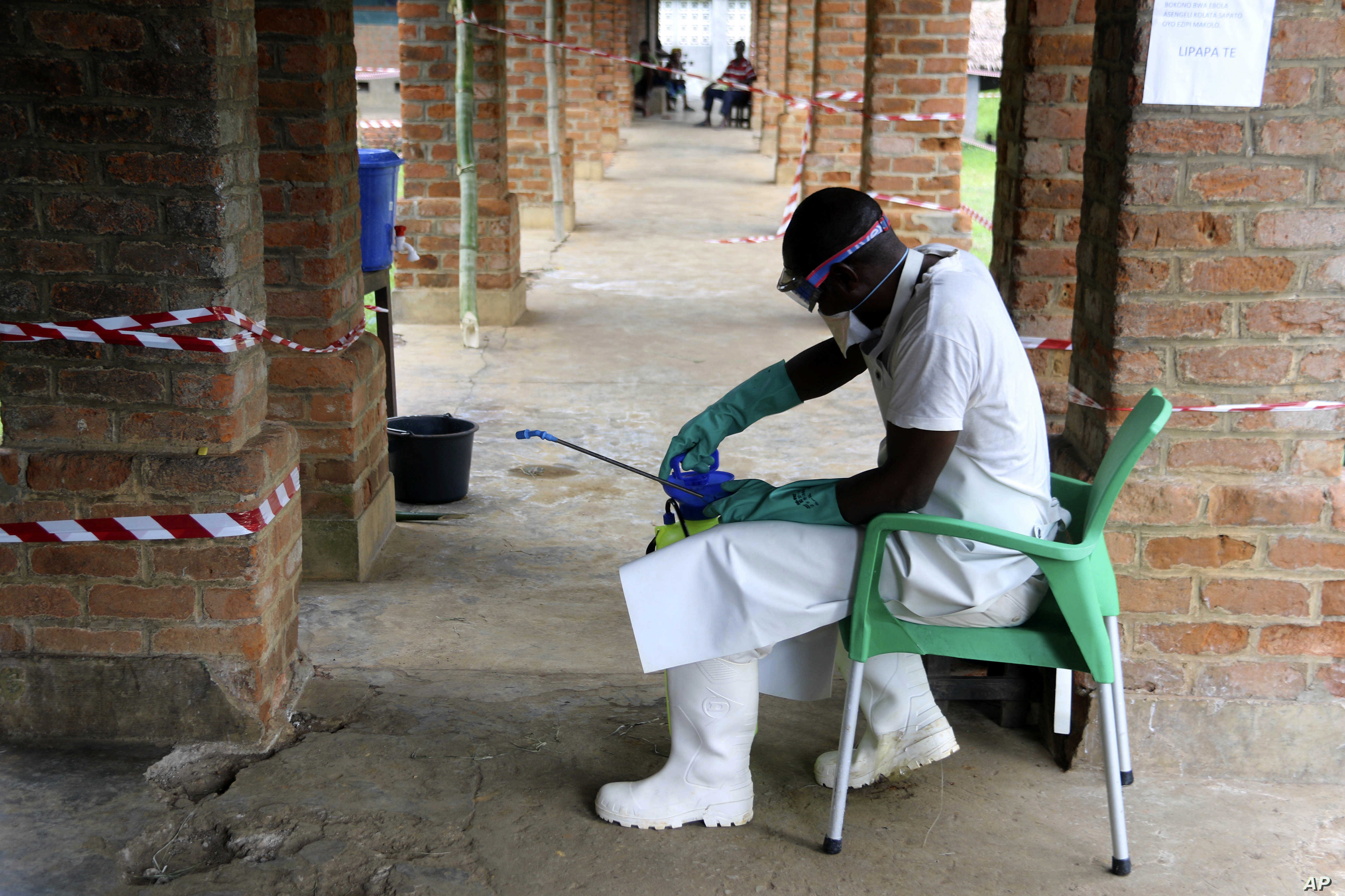 A health care worker wears virus protective gear at a treatment center in Bikoro, Democratic Republic of Congo, May 13, 2018. Congo's latest Ebola outbreak has spread to a city of more than 1 million people, a worrying shift as the deadly virus risks...