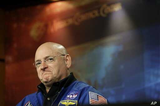 NASA astronaut Scott Kelly listens to a question about his scheduled mission aboard the International Space Station during a briefing at Johnson Space Center in Houston, December 5, 2012.